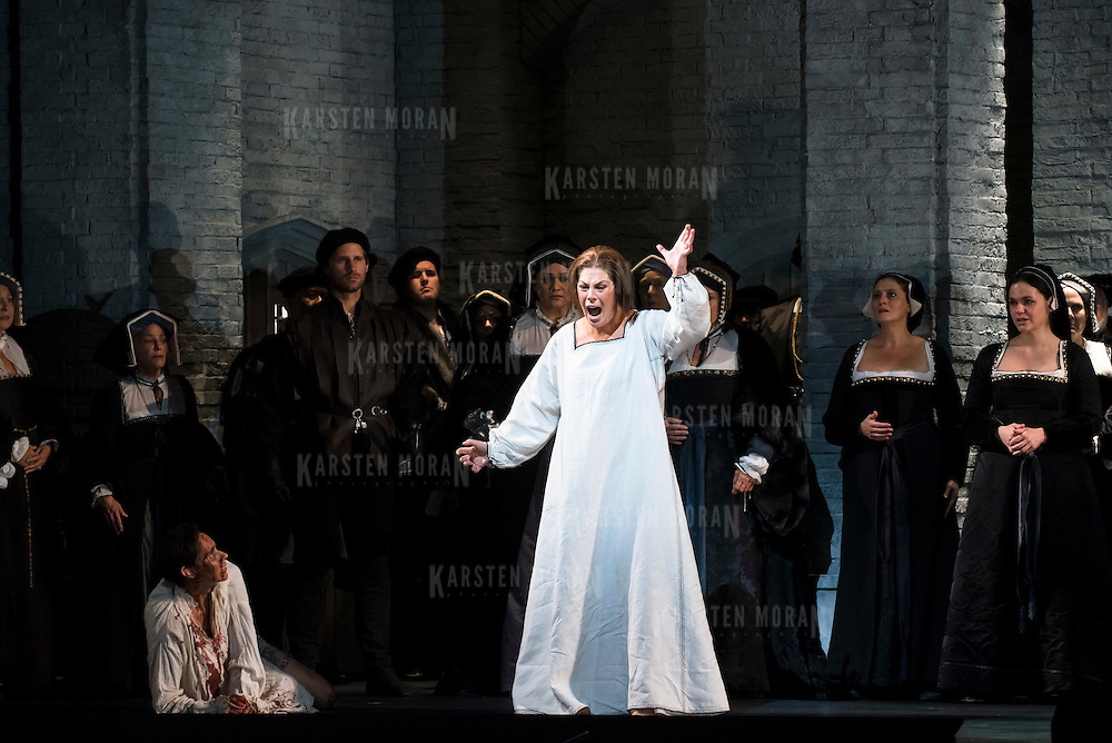 September 23, 2015 - New York, NY : Sondra Radvanovsky, in white at center (as Anna (Boleyn) Bolena) and Tamara Mumford (as Mark Smeato), in white at bottom left, perform in a dress rehearsal for Gaetano Donizetti's 'Anne Bolena' at the Metropolitan Opera at Lincoln Center on Wednesday. CREDIT: Karsten Moran for The New York Times