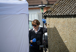 © Licensed to London News Pictures. 16/05/2017. London, UK. An area being scanned by a police search team as the search continues for the body of murdered schoolgirl Danielle Jones at a block of garages in Stifford Clays in Thurrock, Essex. The 15-year-old was last seen on Monday June 18 2001 at about 8am when she left her home in East Tilbury to catch the bus to school.  Photo credit: Ben Cawthra/LNP