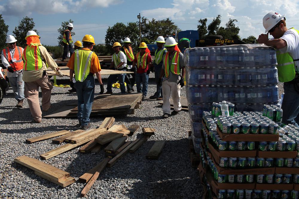 BP contractors leave Delacroix Island, LA on September 01, 2010.