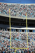 A crowd of fans frames the background of the goal post in the foreground during the Carolina Panthers NFC Divisional Playoff NFL football game against the San Francisco 49ers on Sunday, Jan. 12, 2014 in Charlotte, N.C. The 49ers won the game 23-10. ©Paul Anthony Spinelli