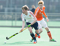 ROTTERDAM -    Tomas Russell (Eng) with David Luijckx (r) .     Practice Match  Hockey : Netherlands Boys U16  v England U16 . COPYRIGHT KOEN SUYK