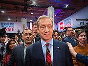 """14 JANUARY 2020 - DES MOINES, IOWA: California businessman TOM STEYER walks through the crowd in the """"spin room"""" at the CNN Democratic Presidential Debate on the campus of Drake University in Des Moines. This is the last debate before the Iowa Caucuses on Feb. 3.    PHOTO BY JACK KURTZ"""