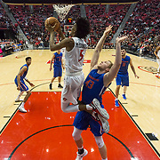 27 February 2018: San Diego State men's basketball hosts Boise State in their last meet up of the regular season at Viejas Arena. San Diego State Aztecs forward Jalen McDaniels (5) goes for reverse lay up while being defended by Boise State Broncos forward Christian Sengfelder (43) in the second half. The Aztecs beat the Broncos 72-64.  <br /> More game action at sdsuaztecphotos.com
