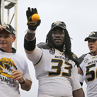 ORLANDO, FL - JANUARY 01:  Head coach Gary Pinkel, MVP Markus Golden #33 and Shane Ray #56 of the Missouri Tigers celebrate on the podium after winning the Buffalo Wild Wings Citrus Bowl between the Minnesota Golden Gophers and the Missouri Tigers at the Florida Citrus Bowl on January 1, 2015 in Orlando, Florida. (Photo by Alex Menendez/Getty Images) *** Local Caption *** Gary Pinkel; Markus Golden; Shane Ray