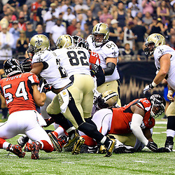 Oct 15, 2015; New Orleans, LA, USA; New Orleans Saints running back Mark Ingram (22) breaks a tackle by Atlanta Falcons outside linebacker Nate Stupar (54) on a touchdown run during the first quarter of a game at the Mercedes-Benz Superdome. Mandatory Credit: Derick E. Hingle-USA TODAY Sports
