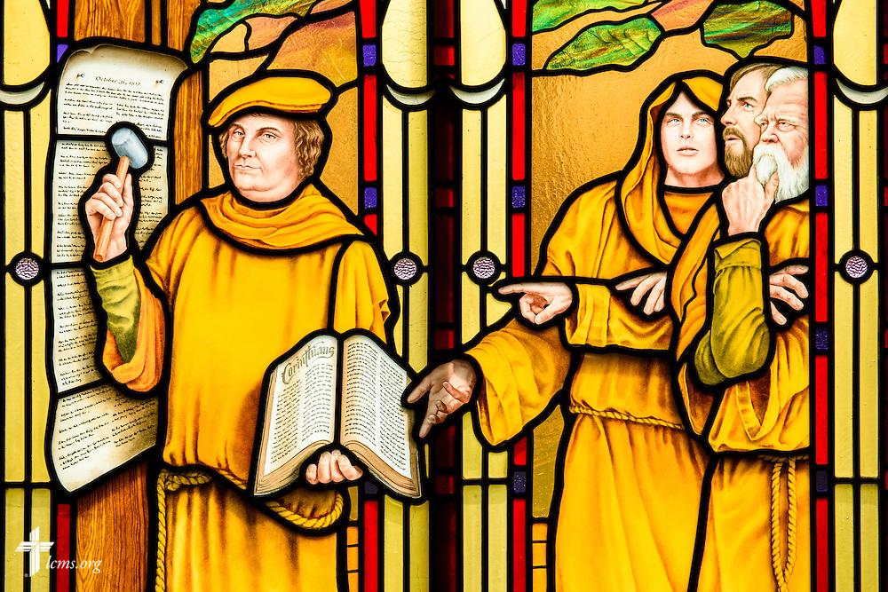 Stained glass at St. Paul Evangelical Lutheran Church in Columbus, Ind., depicts Martin Luther nailing the 95 Theses to the Castle Church in Wittenberg, Germany, photographed Sunday, April 10, 2016. LCMS Communications/Erik M. Lunsford