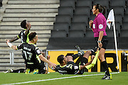 The Bury players  slide into the corner to celebrate Bury midfielder Zeli Ismail (7) goal (1-3) during the EFL Sky Bet League 1 match between Milton Keynes Dons and Bury at stadium:mk, Milton Keynes, England on 27 September 2016. Photo by Dennis Goodwin.