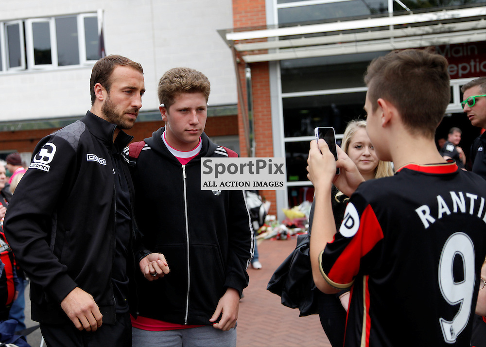 Glen Murray poses for a photo with a fan During Bournemouth vs Watford on Saturday 3rd of October 2015.