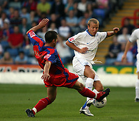 Photo: Chris Ratcliffe.<br /> Crystal Palace v Southend United. Coca Cola Championship. 08/08/2006.<br /> Luke Guttridge (R) of Southend clashes with Danny Butterfield of Crystal Palace.