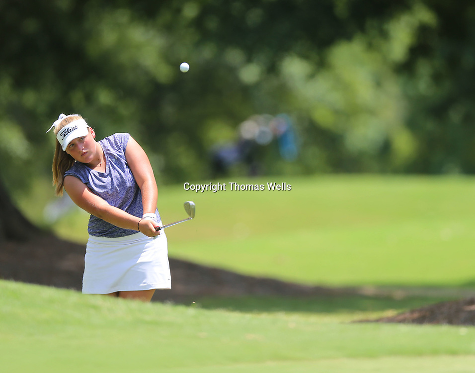 Riley Mayhew chips onto the first green to start her back nine on Friday at the Tupleo Country Club.