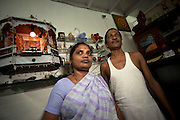 Manisha Mohan Pawar and Mohan Mahadev Pawar in their home in a slum area in Malabar Hills, Mumbai (Bombay), India. They belong to the Dalit group.