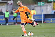 AFC Wimbledon goalkeeper George Long (1) clearing the ball during the The FA Cup match between AFC Wimbledon and Charlton Athletic at the Cherry Red Records Stadium, Kingston, England on 3 December 2017. Photo by Matthew Redman.