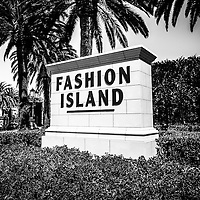 Fashion Island sign black and white picture. Fashion Island is an upscale shopping mall in the wealthy seaside city of Newport Beach in Orange County Southern California. The photo is high resolution and was taken in 2012.