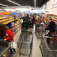 Shoppers pack the isles at ALDI in Tupelo on Wednesday morning. The store held its grand opening where the first 100 customers received a golden ticket containing ALDI gift cards of various amounts.