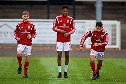 MERTHYR TYDFIL, WALES - Thursday, November 2, 2017: Wales' Chris Craven, Liam Ihekwoaba and Charlie Hughes during the pre-match warm-up before an Under-18 Academy Representative Friendly match between Wales and Newport County at Penydarren Park. (Pic by David Rawcliffe/Propaganda)