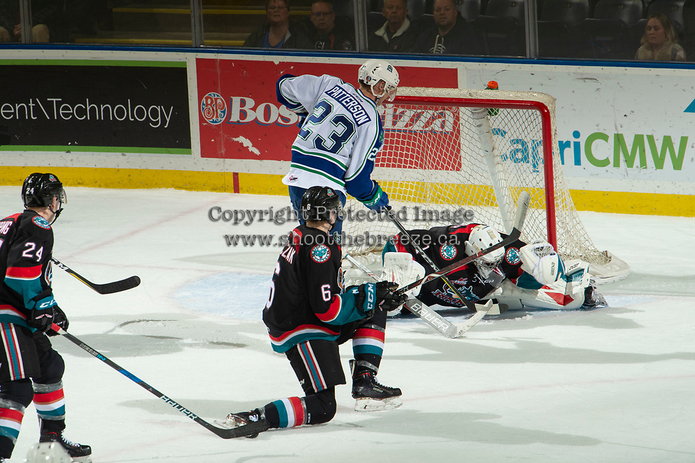 KELOWNA, CANADA - OCTOBER 23: James Porter #1 of the Kelowna Rockets makes a glove save against the Swift Current Broncos  on October 23, 2018 at Prospera Place in Kelowna, British Columbia, Canada.  (Photo by Marissa Baecker/Shoot the Breeze)