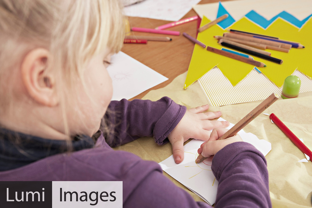 Little Girl In Nursery School Drawing A Picture, Kottgeisering, Bavaria, Germany, Europe