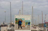 Saint Nazaire, 29/10/2014: Cartellone raffigurante Tin Tin in una scena al porto - Tin Tin's banner, harbour.<br /> &copy; Andrea Sabbadini