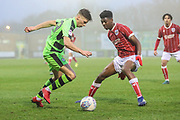 Forest Green Rovers Olly Mehew(29) takes on Bristol City Tyreeq Bakinson(8) during the Gloucestershire Senior Cup match between Forest Green Rovers and U23 Bristol City at the New Lawn, Forest Green, United Kingdom on 9 April 2018. Picture by Shane Healey.