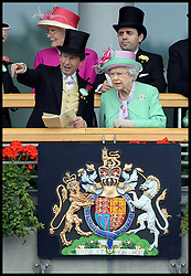 HM The Queen with her racing manager John Warren as they look at horses in the parade ring from the royal box at Royal Ascot 2013<br /> Ascot, United Kingdom<br /> Wednesday, 19th June 2013<br /> Picture by Andrew Parsons / i-Images