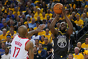 April 30, 2019; Oakland, CA, USA; Golden State Warriors forward Draymond Green (23) shoots the basketball against Houston Rockets forward PJ Tucker (17) during the third quarter in game two of the second round of the 2019 NBA Playoffs at Oracle Arena. The Warriors defeated the Rockets 115-109.