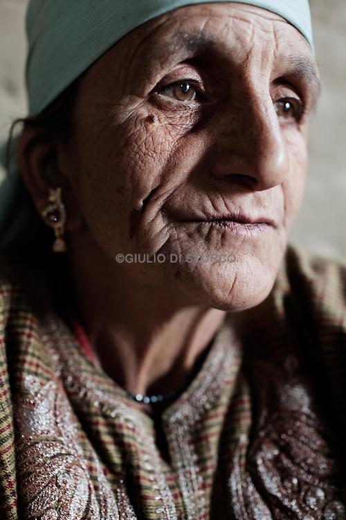 Misra ( 50  Half Widows),.Gulam Rasool Malek is her husband has disappered in 1992, when he was 40 years old. Pattan, Kashmir 2011.