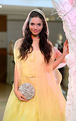 Pictured is a model in the 'Belle' dress from Beauty and the Beast designed by Valentino.<br /> Unique designer dresses inspired by Disney's Iconic Princesses to go under the hammer in aid of Great Ormond Street Hospital at Christie's South Kensington, London, United Kingdom. Friday, 8th November 2013. Picture by Ben Stevens / i-Images