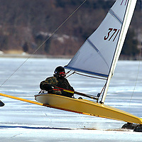 (PSTORE)  Red Bank 1/28/2004   Jon Schwartz of Lincroft has a runner lift off the ice as he sails on the Navesink River.   Michael J. Treola Staff Photographer...MJT    .
