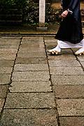 Monk walking on stone pathway. on stone pathway.