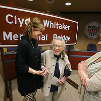 Members of the Whitaker family, Julia Whitaker Lange, from left, Jo Whitaker, and Deborah Whitaker George celebrate the unveiling of a sign that will name the bridge on Coley Road in Tupelo that spans I-22 the Cylde Whitaker Memorial Bridge.