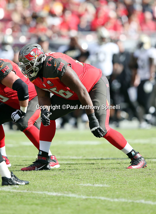 Tampa Bay Buccaneers offensive tackle Donovan Smith (76) gets set for the snap during the 2015 week 14 regular season NFL football game against the New Orleans Saints on Sunday, Dec. 13, 2015 in Tampa, Fla. The Saints won the game 24-17. (©Paul Anthony Spinelli)
