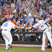NEW YORK, NEW YORK - June 16: Pitcher Bartolo Colon #40 of the New York Mets is congratulated by Neil Walker #20 of the New York Mets as he scores a run during the Pittsburgh Pirates Vs New York Mets regular season MLB game at Citi Field on June 16, 2016 in New York City. (Photo by Tim Clayton/Corbis via Getty Images)