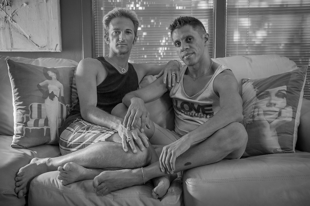 """Tim Lewis with his friend, Juan Roman Caruz' Jererz, at his home  in Anchorage's South Addition Neighborhood.  """"I'm a control freek, I like everything exactly the way I want it."""""""