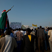 A crowd gathers around the unveiled statue of John Garang de Mabior, the historical leader of Sudan People's Liberation Army (SPLA) during the second sudanese civil war, ahead of the official ceremony marking South Sudan as an independent nation.