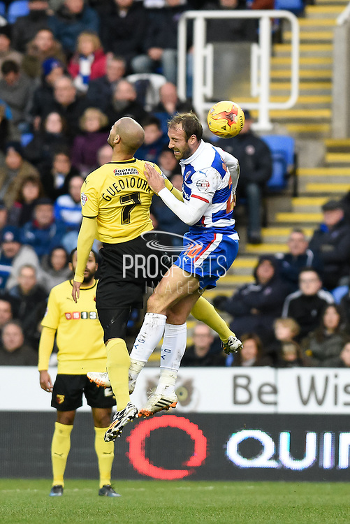 Adlène Guédioura challenges Glenn Murray during the Sky Bet Championship match between Reading and Watford at the Madejski Stadium, Reading, England on 20 December 2014. Photo by David Charbitt.