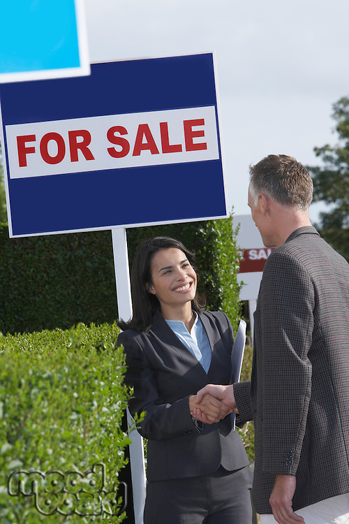 Real Estate Agent and Client Shaking Hands