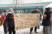 Loreena Garvey-Shepley, left, and Richard Dalkeith hold a hand drawn sign at the start of the Colten Boushie prayer rally at the Windsor Courthouse in Windsor, Ontario, Canada. This is the second Windsor event after the 09 February 2018 not guilty verdict into the death of Boushie.