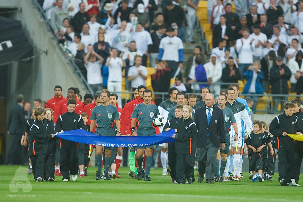 The New Zealand All Whites and Bahrain enter the field at Westpac Stadium to start the second leg of the 2010 FIFA World Cup qualifying game in front a record 35,194 football fans on November 14, 2009 largest attendance for a football game in New Zealand. The match is under the supervision of uruguayan referee Jorge Larrionda.