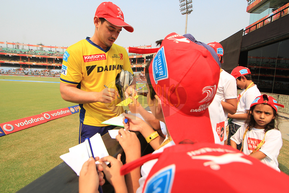 Quinton de Kock of Delhi Daredevils with fever 104 FM fans during match 26 of the Vivo IPL ( Indian Premier League ) 2016 between the Delhi Daredevils and the Kolkata Knight Riders held at The Feroz Shah Kotla Ground in Delhi, India,  on the 30th April 2016<br /> <br /> Photo by Arjun Singh / IPL/ SPORTZPICS