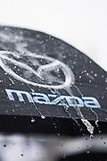 March 12-16, 2019: Mobil 1 12 hours of Sebring. Mazda umbrella in the rain.