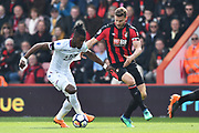 Wilfried Zaha (11) of Crystal Palace on the attack with Simon Francis (2) of AFC Bournemouth challenging him during the Premier League match between Bournemouth and Crystal Palace at the Vitality Stadium, Bournemouth, England on 7 April 2018. Picture by Graham Hunt.