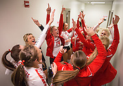 The Sidney Lady Raiders volleyball team sings together outside their locker room before their Class A opening round state match against Grand Island Northwest at the Pinnacle Bank Arena on Thursday, Nov. 10, 2016, in Lincoln.