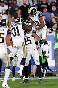 Los Angeles Rams free safety Maurice Alexander (31) and Los Angeles Rams cornerback Trumaine Johnson (22) leap onto Los Angeles Rams strong safety T.J. McDonald (25) after McDonald intercepts a late fourth quarter pass during the 2016 NFL week 17 regular season football game against the Arizona Cardinals on Sunday, Jan. 1, 2017 in Los Angeles. The Cardinals won the game 44-6. (©Paul Anthony Spinelli)