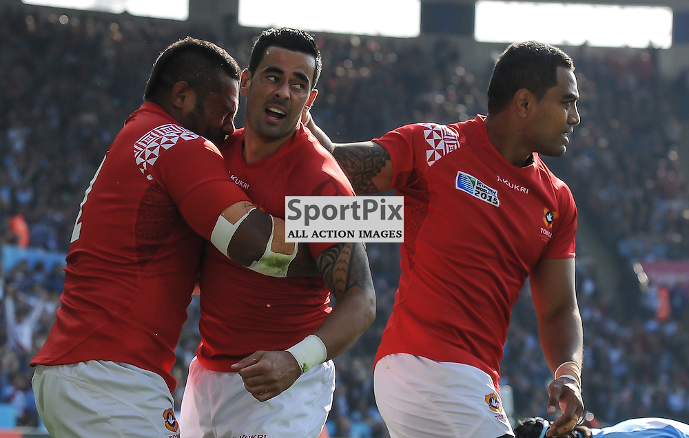 Kurt Morath of Tonga is congratulated by his team mates after scoring the game's opening try (c) Simon Kimber | SportPix.org.uk
