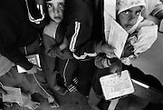 Jabalya Refugee Camp, Gaza 1988. Children waiting with food coupons at the UNRWA centre.