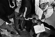 Jabalya Refugee Camp, Gaza 1988. Children waiting with food coupons at the UNRWA centre.