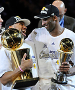 Derek Fisher and Kobe Bryant celebrate while holding the championship and MVP throphies. The Lakers defeated the Boston Celtics in game 7 of the NBA Finals  83-79 in Los Angeles, CA 06/16/2010 (John McCoy/Staff Photographer)