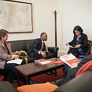 Representative Pramila Jayapal (D-WA, 7) listens to (from left), --, -- and -- of the National Association of Independent Colleges and Universities, on Tuesday, January 31, 2017.  This was the last of 4 30-minute meetings with constituent advocacy groups during the day.  John Boal photo/for The Stranger