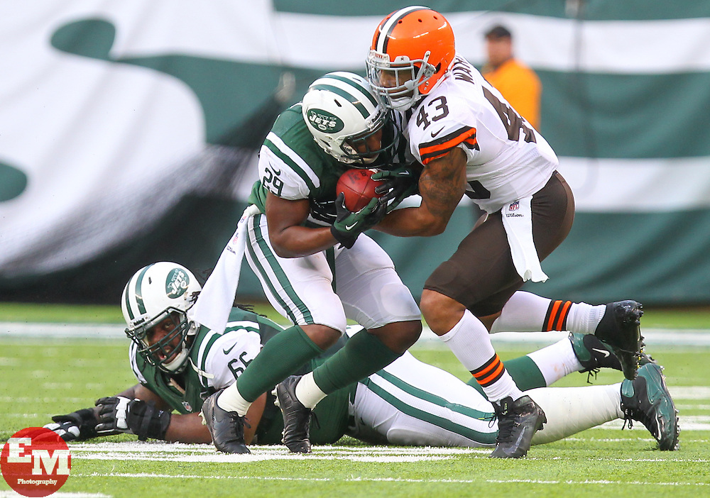 Dec 22, 2013; East Rutherford, NJ, USA; New York Jets running back Bilal Powell (29) is tackled by Cleveland Browns strong safety T.J. Ward (43) during the second half at MetLife Stadium.  The Jets defeated the Browns 24-13.