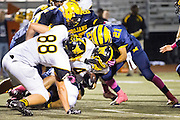 Milpitas High School freshman, Jarred Green (21), makes a tackle during the Oct. 5, 2012, home game against Mountain View.  The Trojans would go on to win 42-7.  Photo by Stan Olszewski/SOSKIphoto.